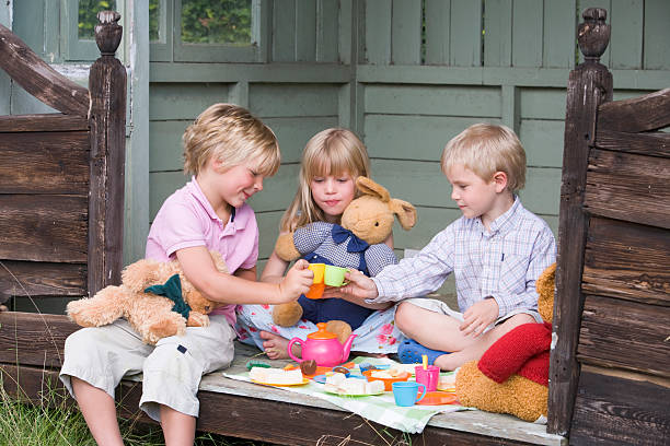 Children in shed playing tea picture id98135322?b=1&k=6&m=98135322&s=612x612&w=0&h=ylccykt46mks8m 9ya6bmfawlviz1wxd2ppdcdzlumi=