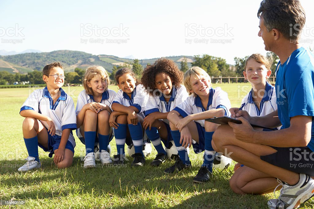 Children In Soccer Team Having Training With Coach royalty-free stock photo