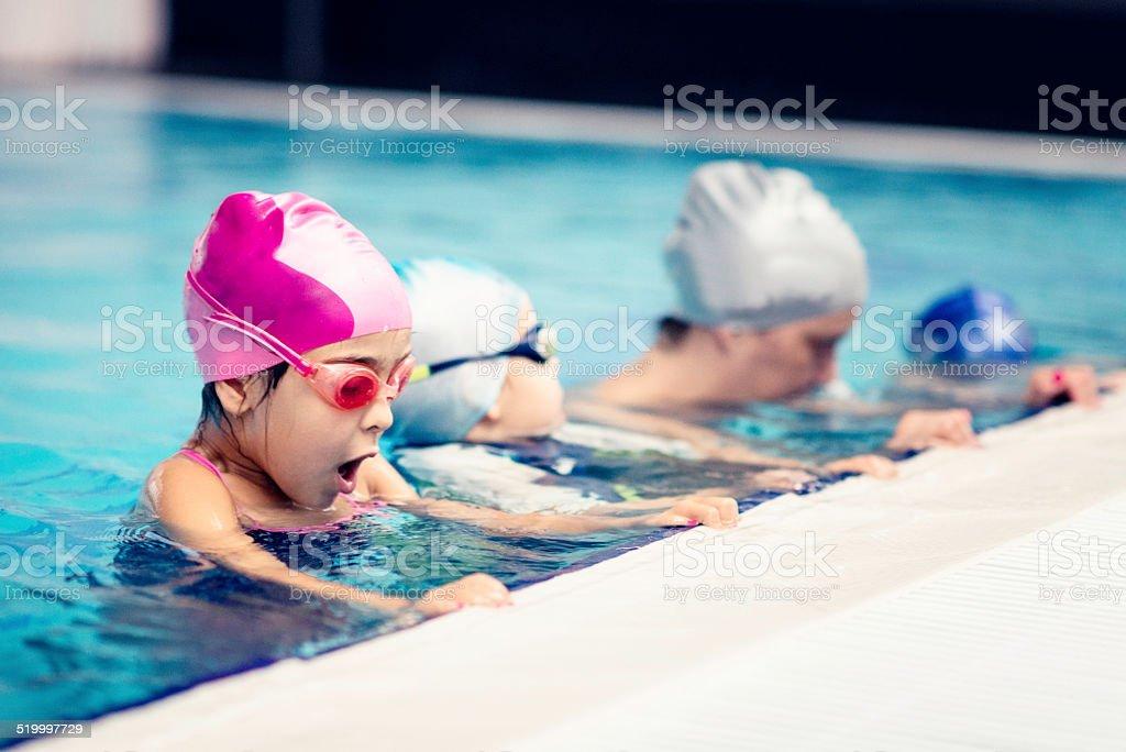 Children in swimming class stock photo