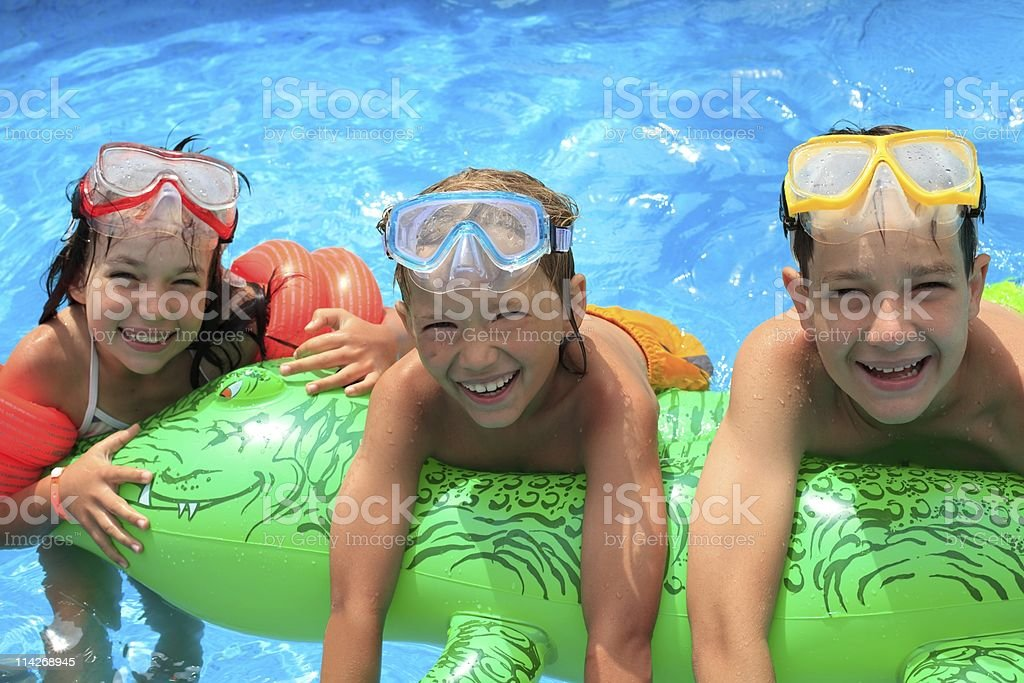 Children in swimming pool royalty-free stock photo