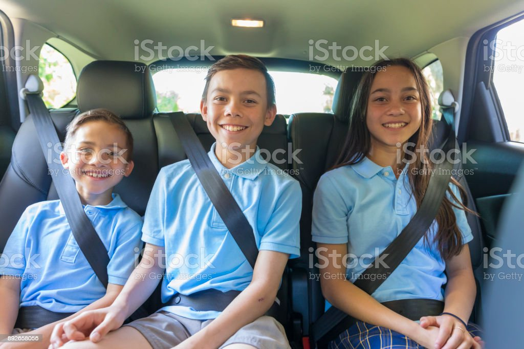 Children in the Car Going to School stock photo