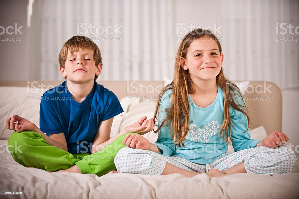 Children  in the lotus position stock photo