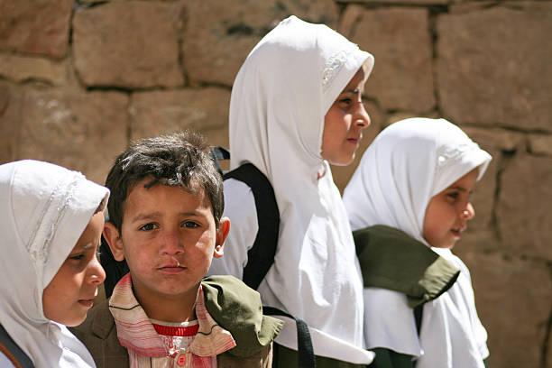 Children in the old town of Sanaa (Yemen). stock photo