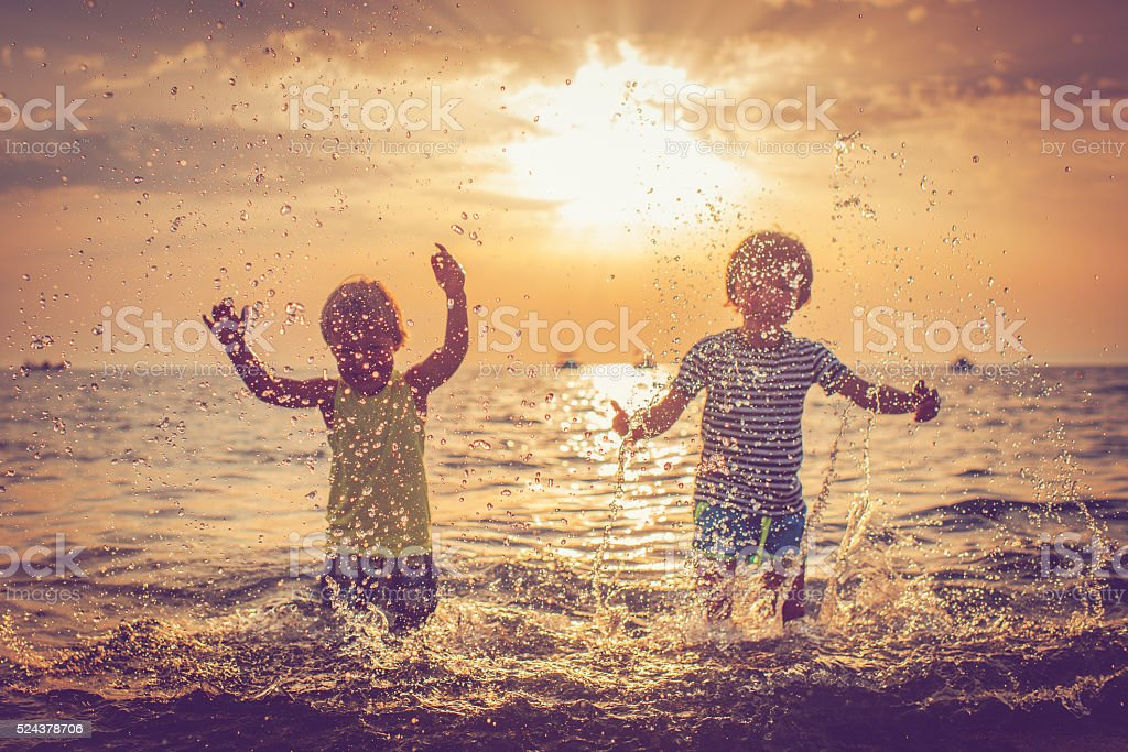 Children in the sea, focus on drops stock photo