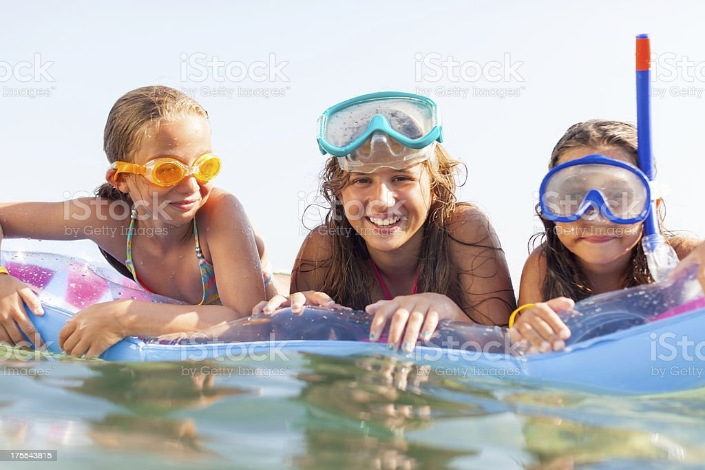 Children in the Sea lying on a  inflatable beach mattress royalty-free stock photo