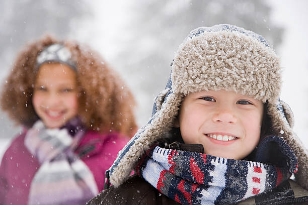 Children in the snow Children in the snow deerstalker hat stock pictures, royalty-free photos & images