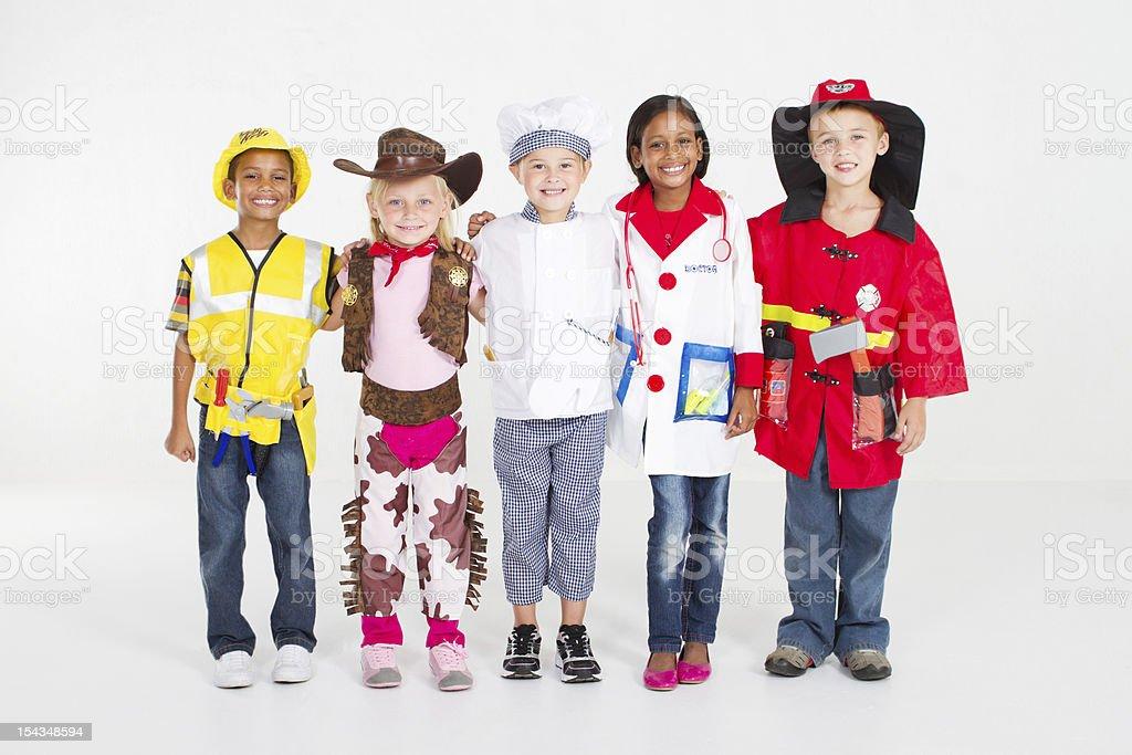 children in various uniforms stock photo