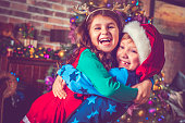 Happy little boy and girl in Christmas near a Christmas tree