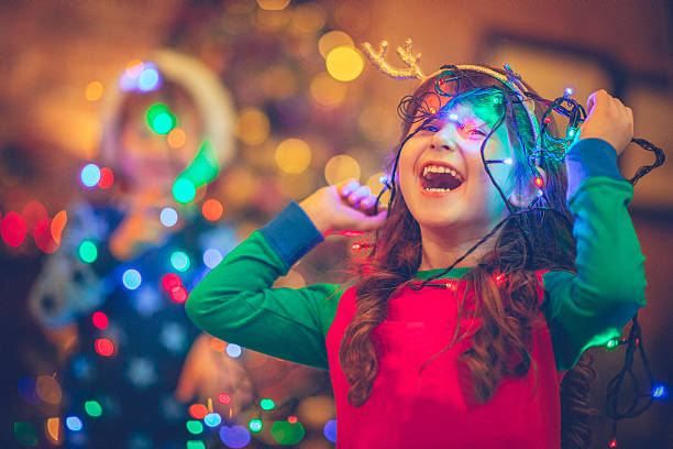 children in xmas - decorating stock photos and pictures