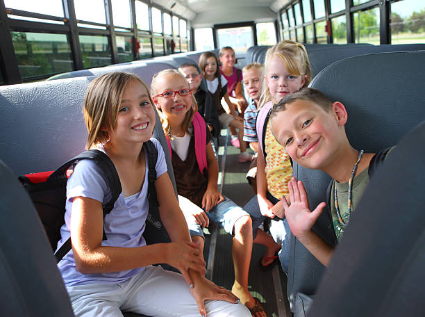 children inside school bus - school bus stock photos and pictures
