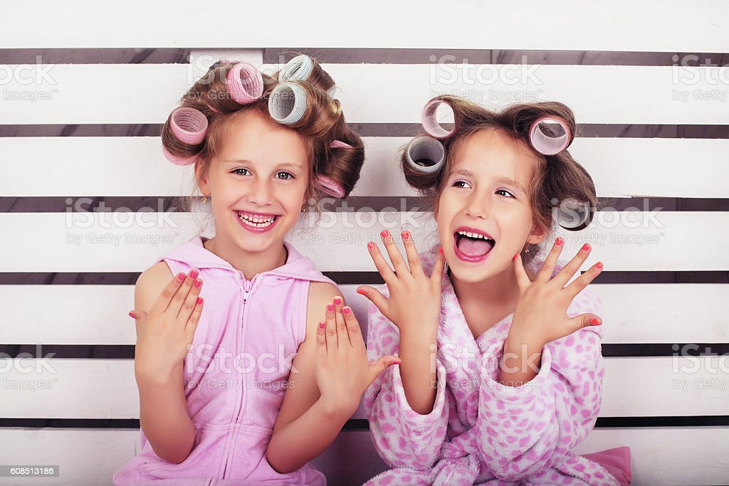 Children laugh and play in a beauty salon stock photo