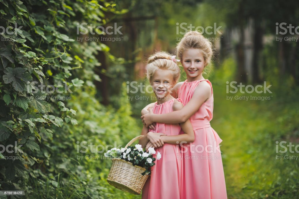 Children laughing and playing in the garden among the green bushes 6591. royalty-free stock photo