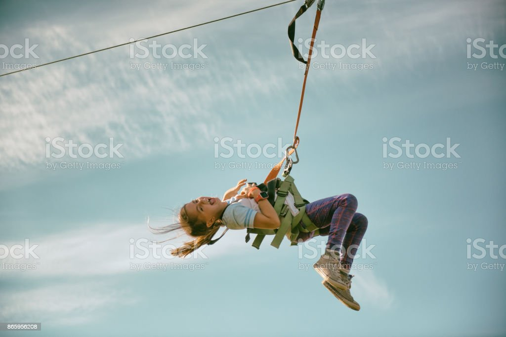 Children laughing zip lines stock photo