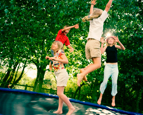 istock 4 children leaping on trampoline 138299695