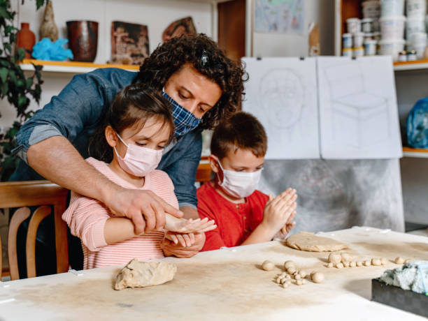 children learn to make clay vases - teacher school solo imagens e fotografias de stock