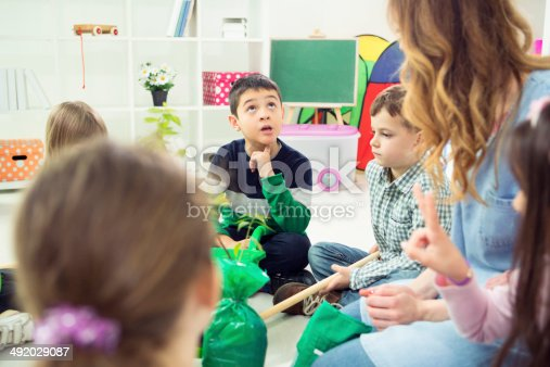 istock Children Learning About Planting a Tree in a kindergarden. 492029087