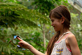Girl holding a butterfly in Costa Rica