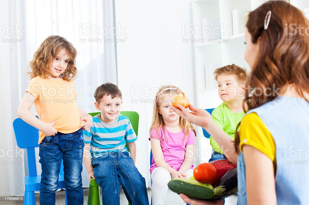 Children Learning about vegetable. stock photo