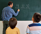 istock Children learning mathematic at classroom on school building. Education 1255433466