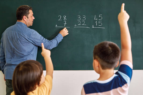 Children learning mathematic at classroom on school building. Education Children learning mathematic at classroom on school building. Education blackboard visual aid stock pictures, royalty-free photos & images