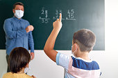 istock Children learning mathematic at classroom on school building. Education 1255433521
