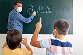 istock Children learning mathematic at classroom on school building. Education 1255433570