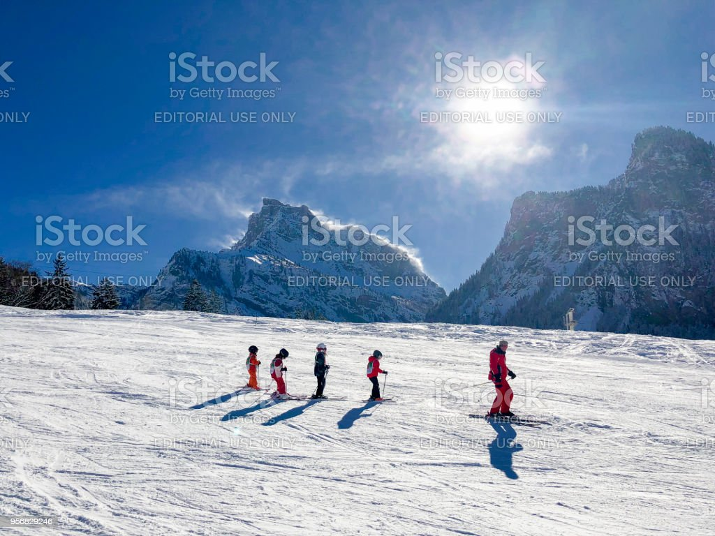 Children Learning to Ski with an Instructor in Samoens, France stock photo