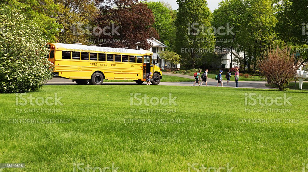 Children Leaving Afternoon School Bus stock photo