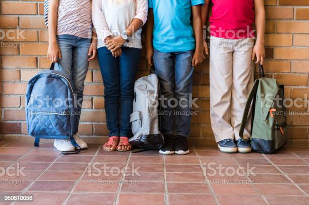 Children legs with backpacks at school picture id950610056?b=1&k=6&m=950610056&s=612x612&h=5nbodnq7kgp z1slx7j tdw0wbt1ljujk4obc3ujp14=