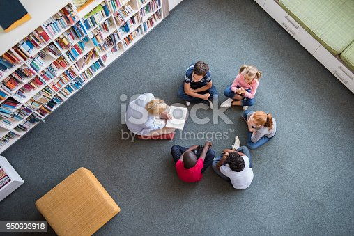 istock Children listening a fairy tale 950603918