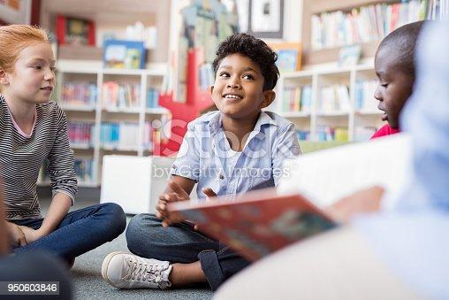 istock Children listening stories 950603846
