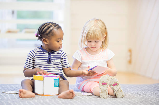 children looking at picture books - sharing stock photos and pictures