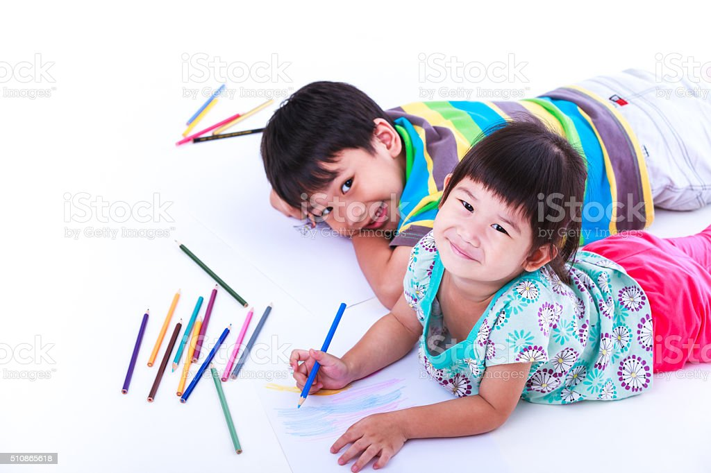 Children looking at the camera and smiling. stock photo
