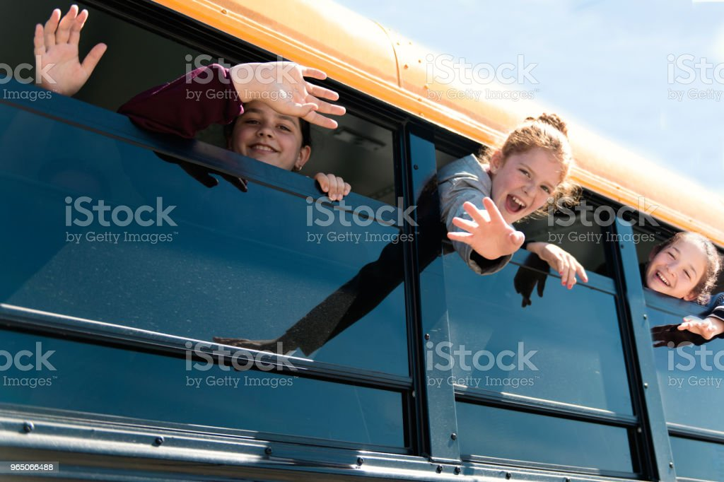 Children looking out school bus window at school's out. royalty-free stock photo