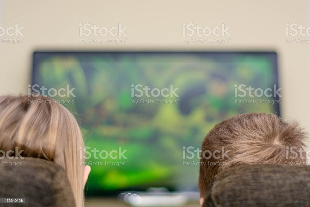 Children looking tv stock photo