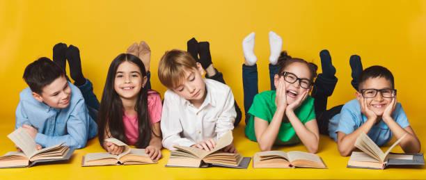 Children lying on floor and reading books picture id1135962012?b=1&k=6&m=1135962012&s=612x612&w=0&h=6svru pua6jt5rx8cefwg5zmtucxj2u 9qkeccdfu2u=