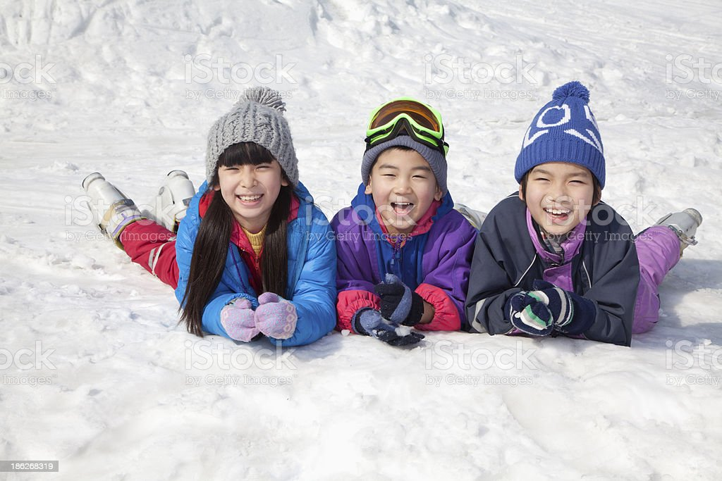 Children Lying on the Snow stock photo