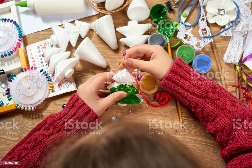 Children make crafts and toys, christmas tree and other. Painting watercolors. Top view. Artwork workplace with creative accessories. Flat lay art tools. stock photo