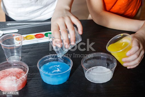 istock Children make experiments with paint and artificial snow 941489026