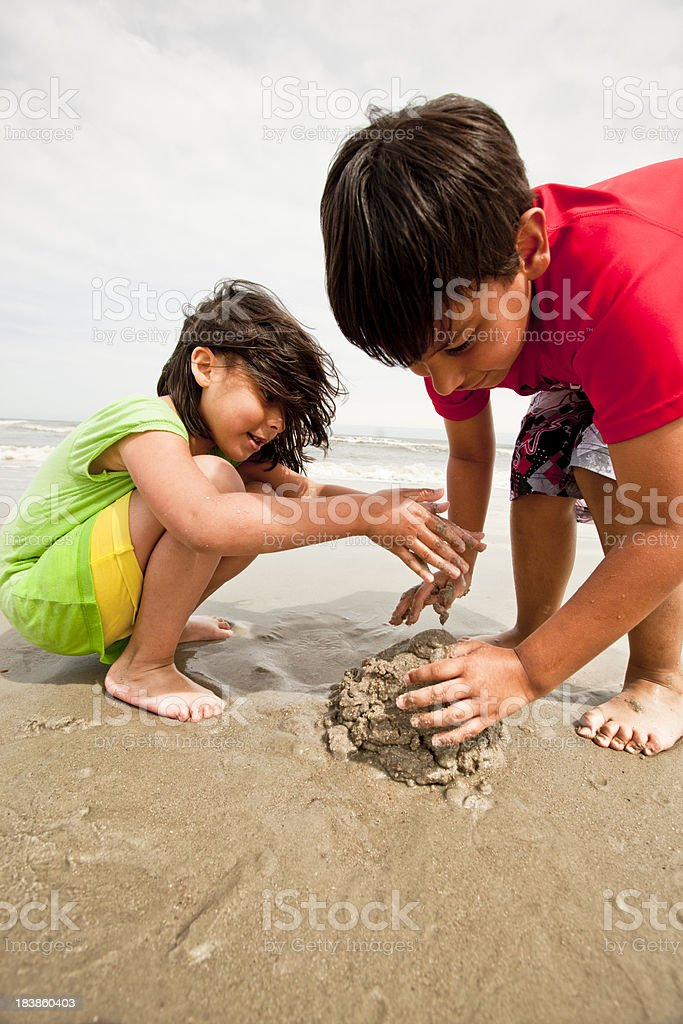 children making a sandcastle royalty-free stock photo