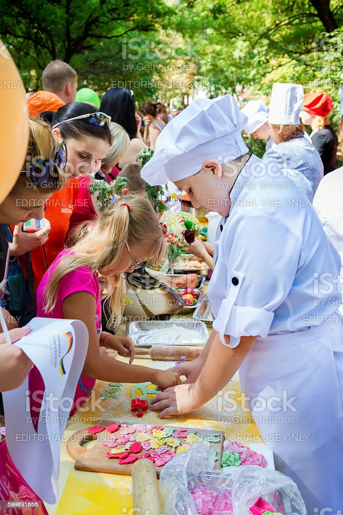 Children making colorful gum paste berry shaped decorations - Photo