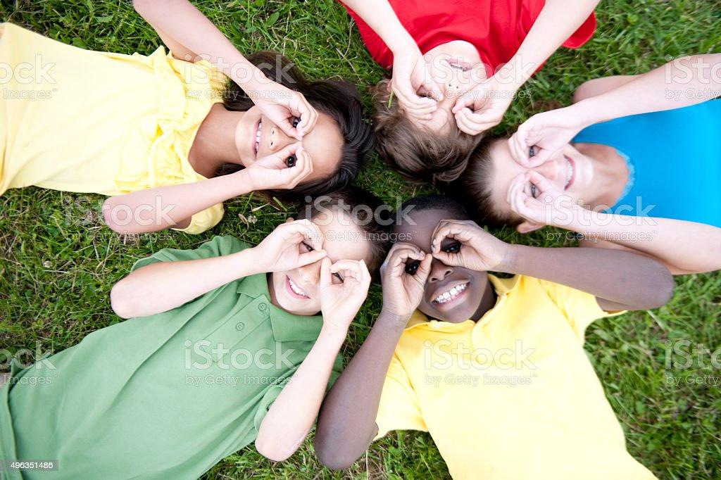 Children Making Pretend Binoculars stock photo