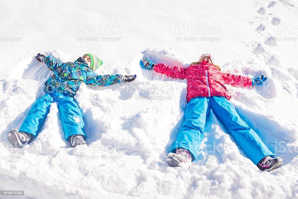 Children making snow angels stock photo