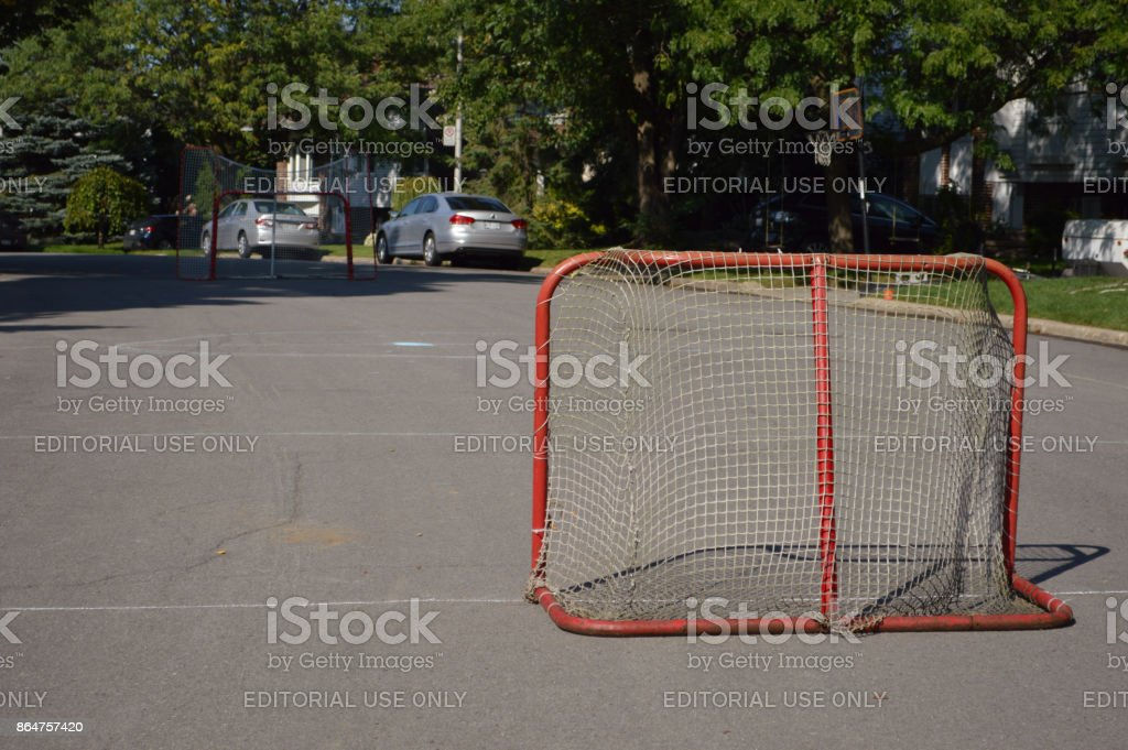Children making sport and having fun in a street hockey game stock photo