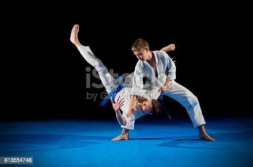 istock Children martial arts fighters 613554746
