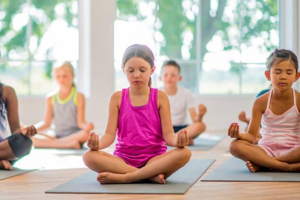 Children Meditating Stock Photo