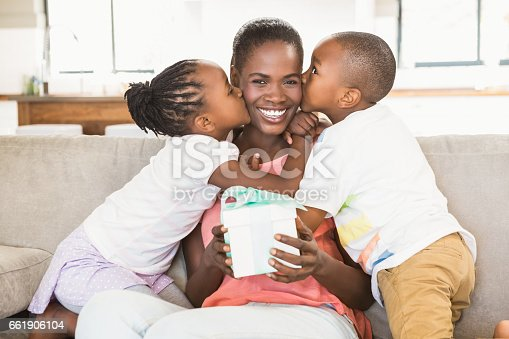 istock Children offering a gift to their mother 661906104