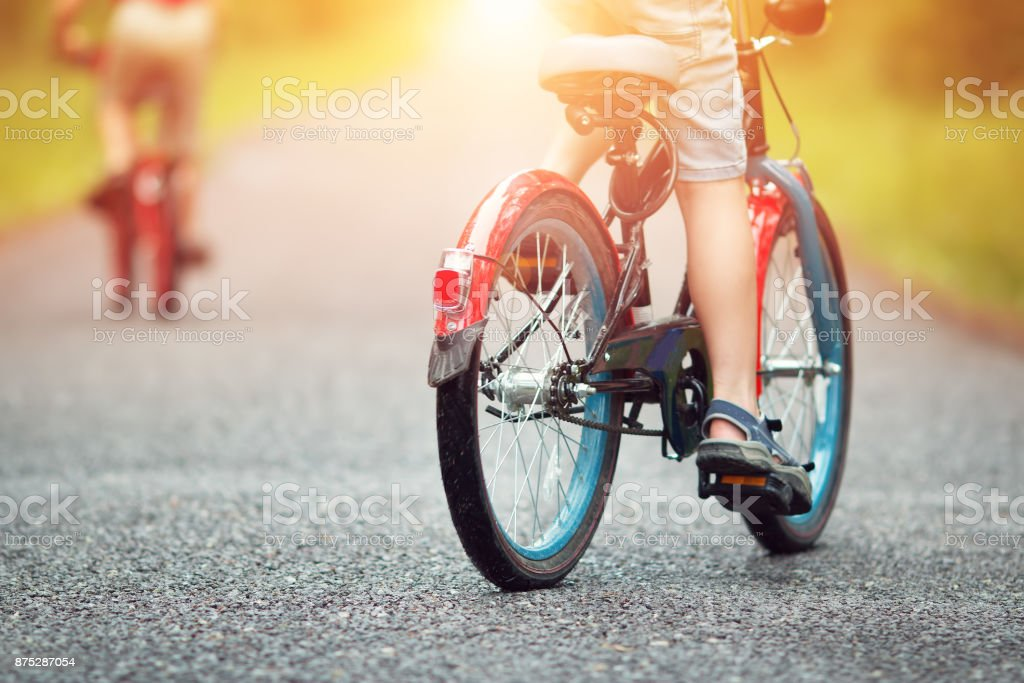 children on a bicycle stock photo
