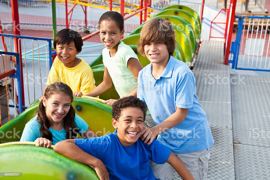 Children on a roller coaster royalty-free stock photo