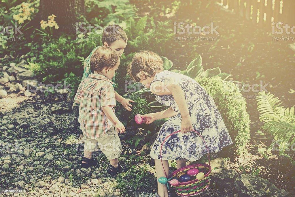 Children on an Easter Egg Hunt - Retro stock photo
